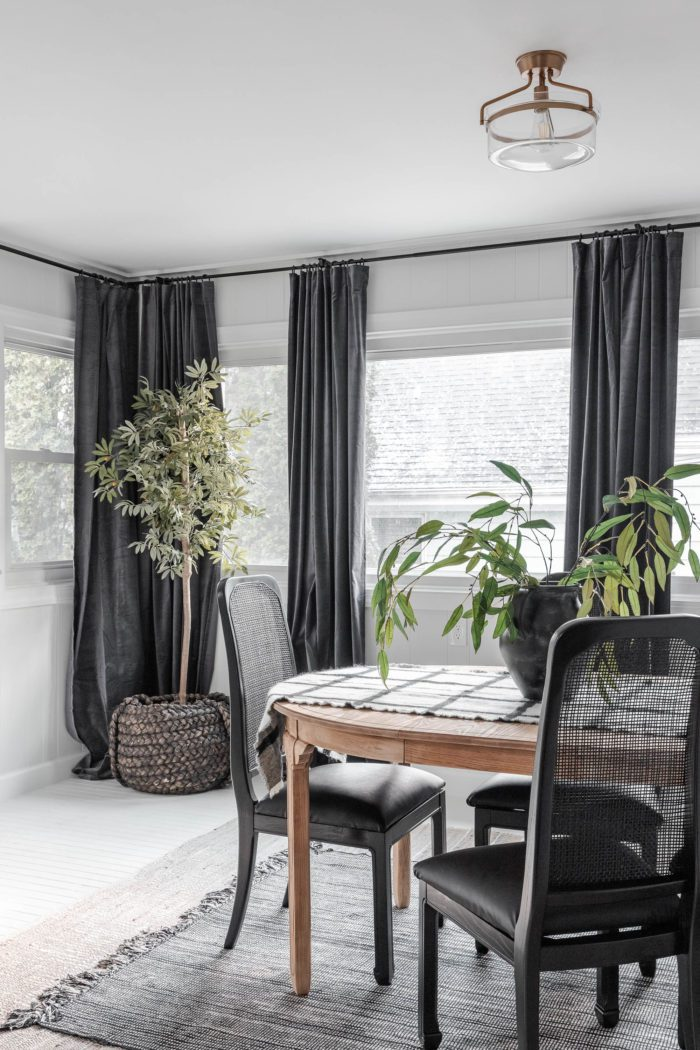 Black curtains in breakfast room makeover.
