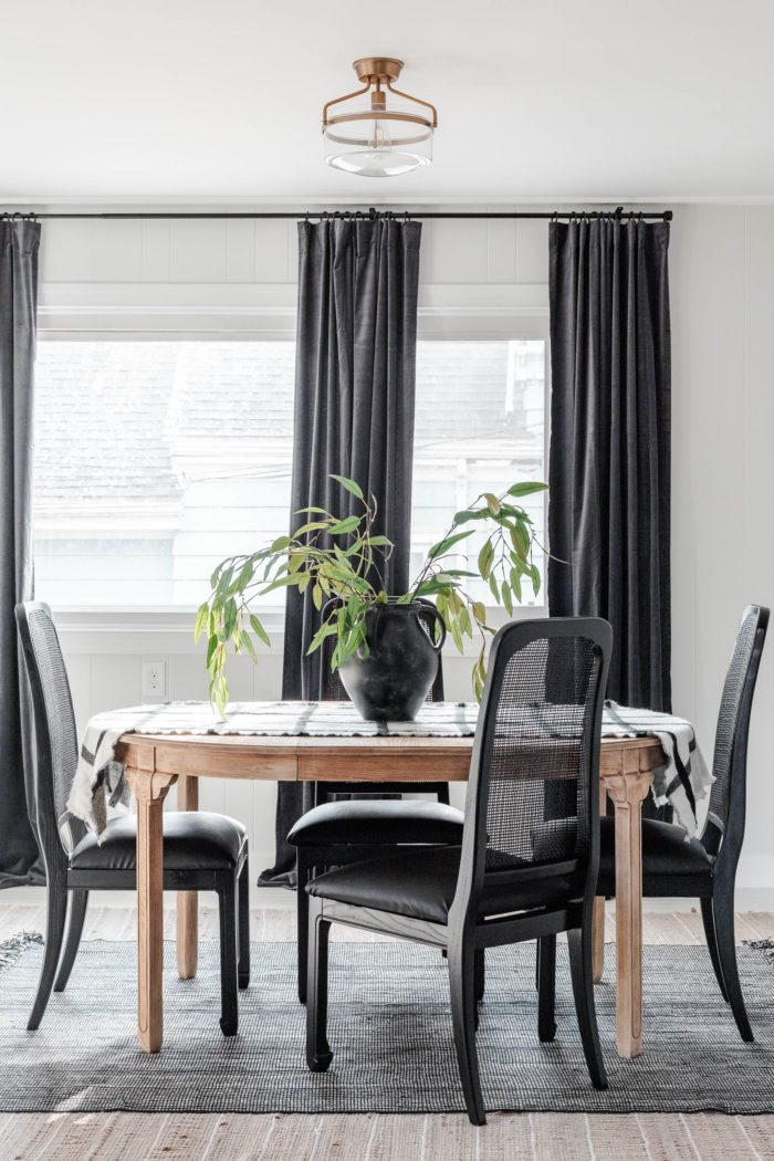 Breakfast Room Table Makeover with black velvet curtains and white walls.