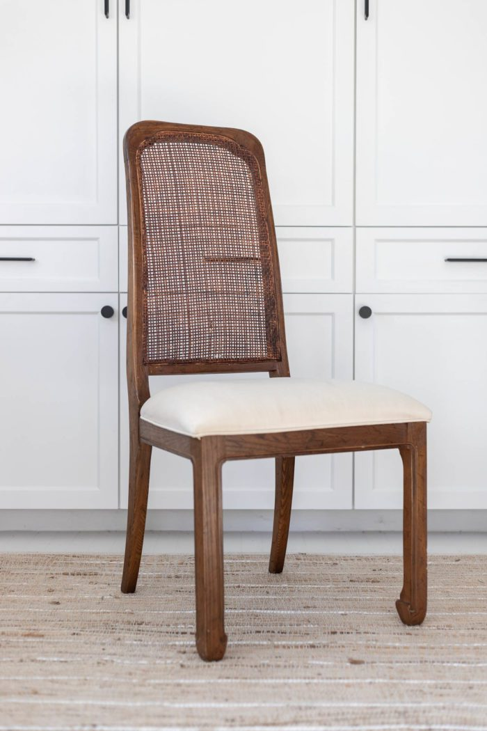 Can chair before with white cushion.