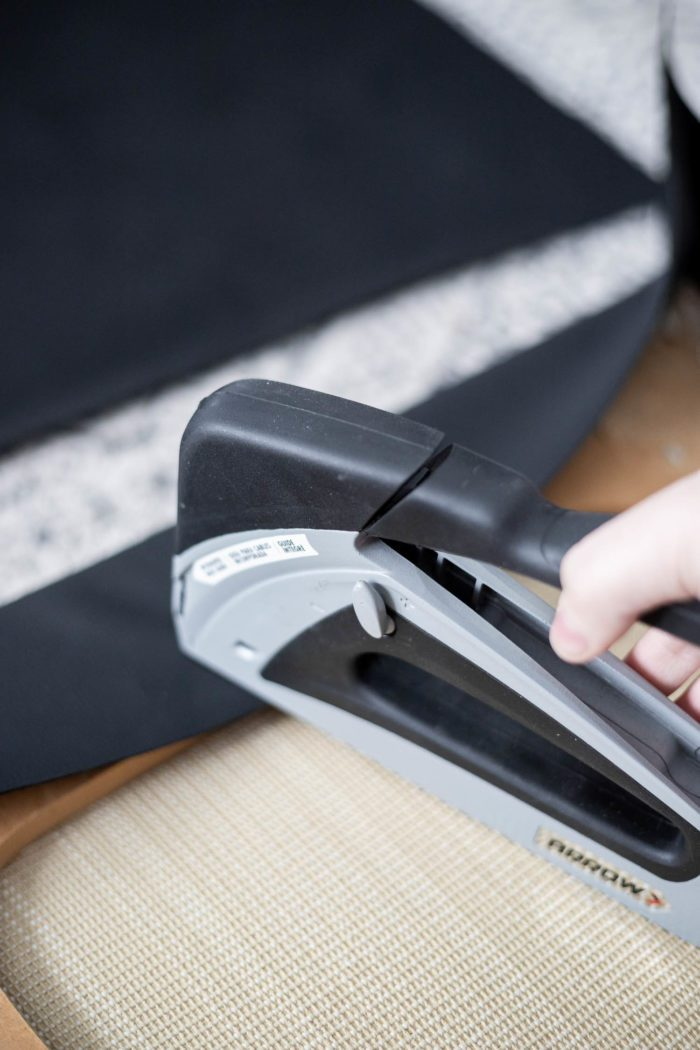 Use Arrow Fastener Stapler for attaching new fabric to chair cushion.