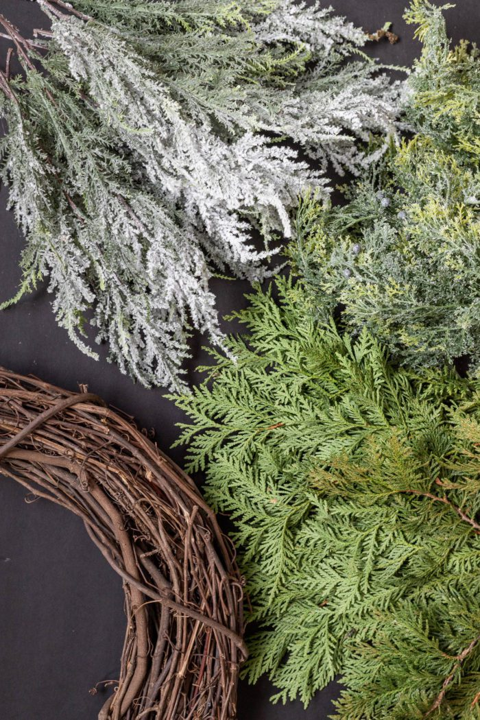 Use faux and real stems for creating a gorgeous full Christmas Wreath.