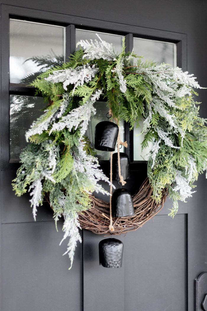 Stunning Modern Organic Christmas Wreath hanging on black front door.