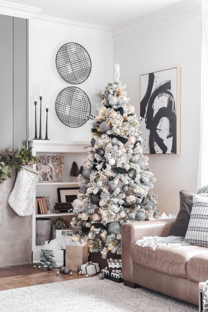 Neutral Modern Cozy Christmas Tree in living room next to built ins. #cherishedbliss #ChristmasTree