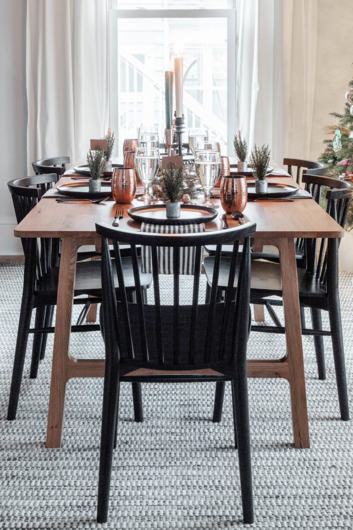 Black chairs, oak table, & a Christmas Tablescape
