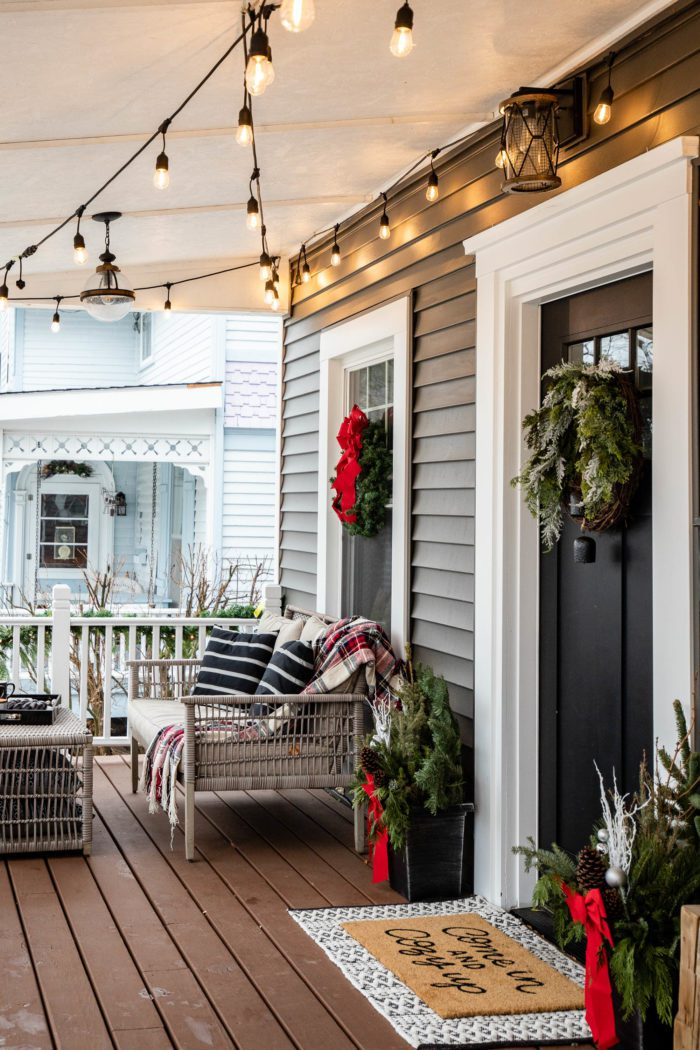 Cozy Christmas Decor on front porch of historical home.