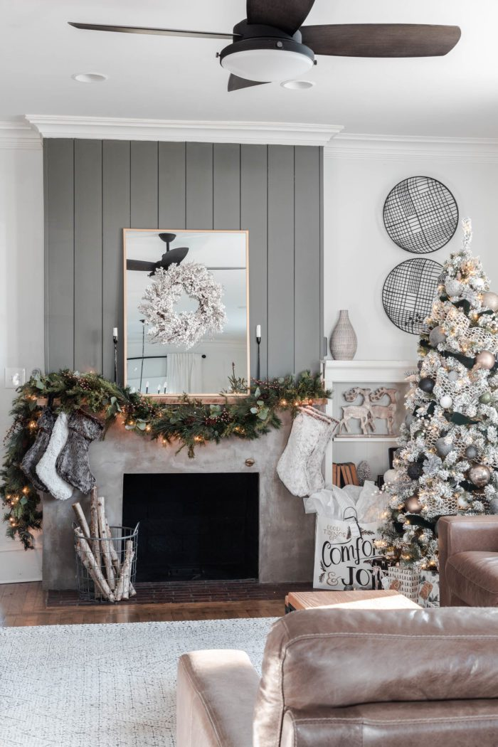 Concrete fireplace with shiplap decorated for Christmas with a Rustic Luxe Christmas Mantel.