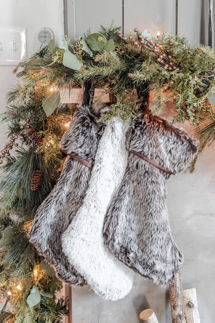 Faux fur stockings on a Christmas Mantel