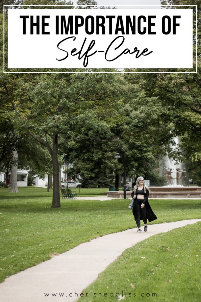 Photo of women walking in a park discussing how Creating a Self Care Routine is necessary for positive mental health. We think there's no time, but it actually helps us be more productive!