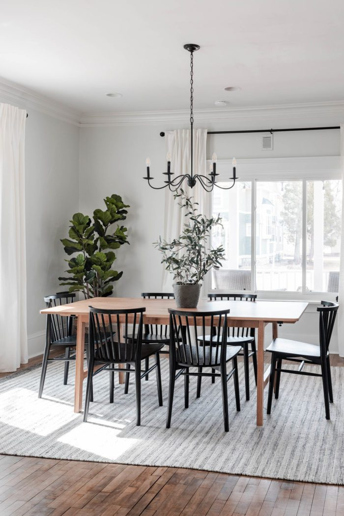 Modern dining room table and chairs with simple spring decor.