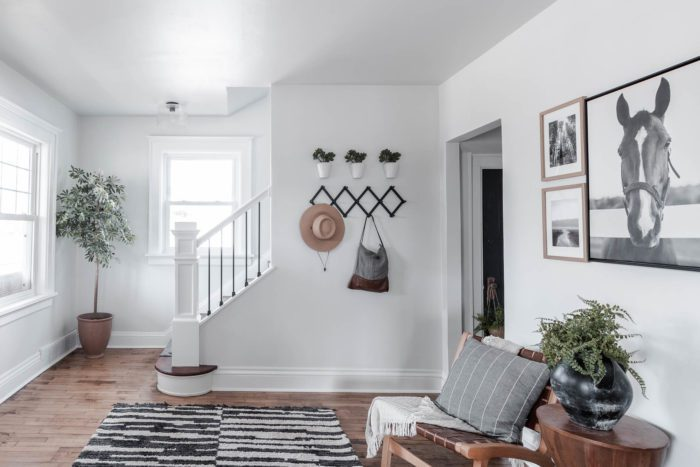 Step into this large entryway that greets you with a gallery wall, two chairs, and plenty of space to hang your coats!