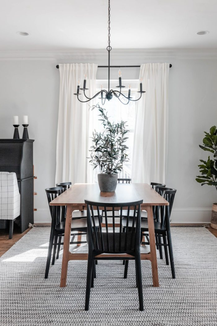 modern dining room decor and faux greenery complete this dining room space for the Neutral Spring Home Tour