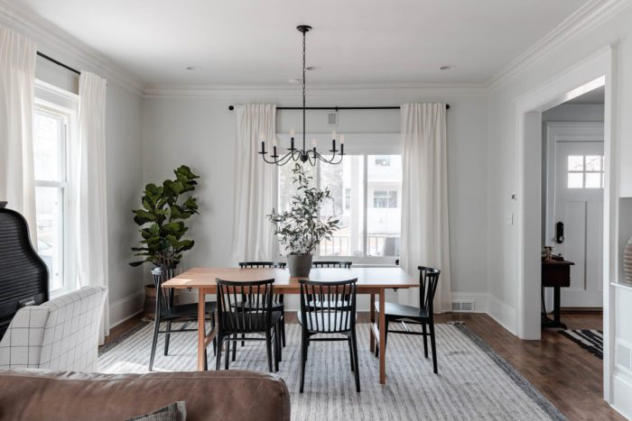 Dining Room decorated for Spring with modern decor and a fresh airy feel!