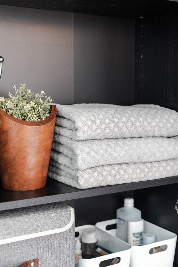 Stacked towels inside an Ikea Billy Bookcase that's being used as a linen closet.