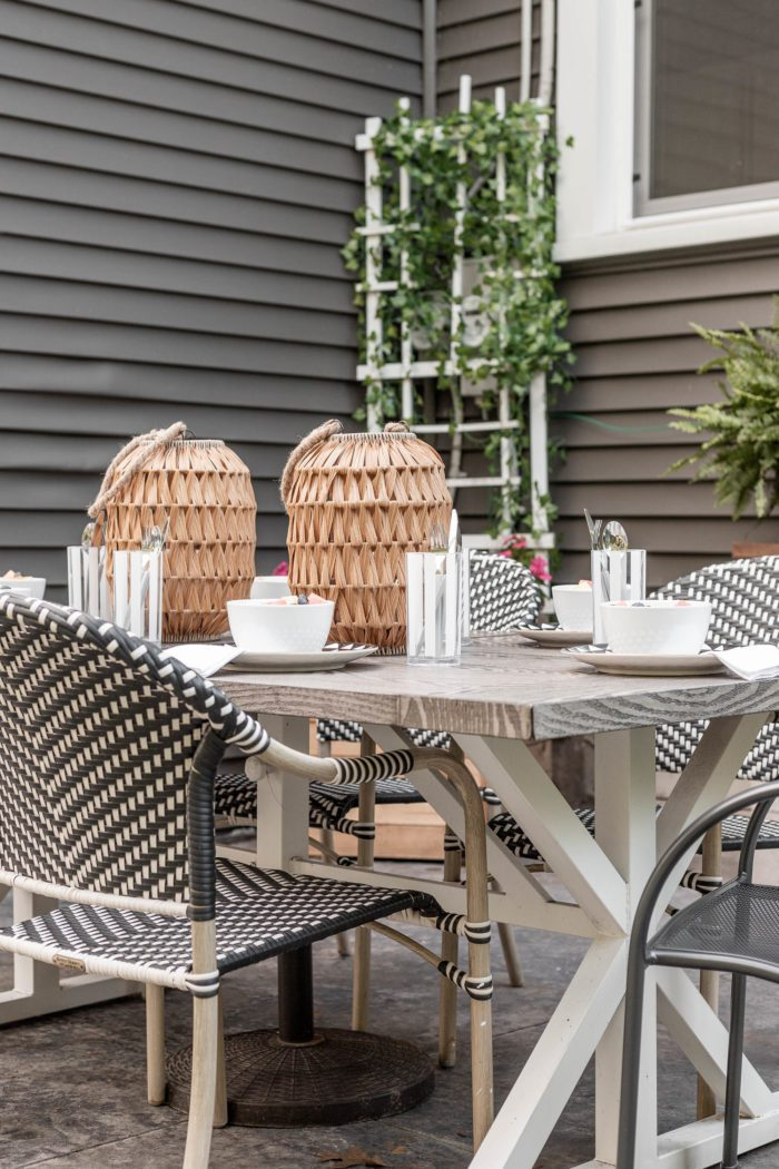 An Outdoor Summer Tablescape on a stamped concrete patio is the perfect way to enjoy a family meal this summer.