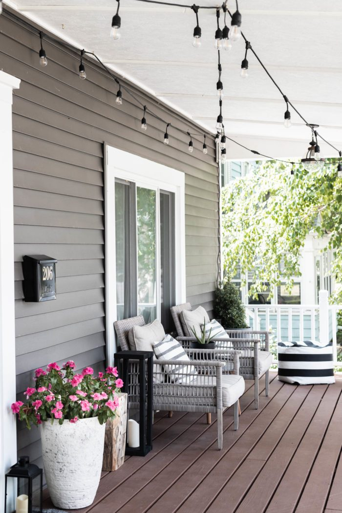 Summer Porch Refresh with fresh flowers, matching chairs, and soft poufs for the perfect evening on this front porch in a Modern Craftsman House.