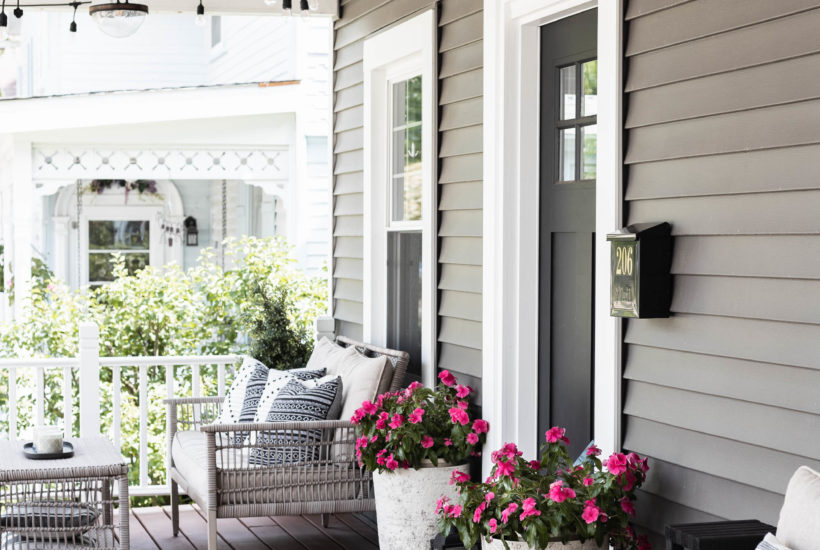 Simple Summer Porch Decor is used in this easy refresh to create a fun, inviting, and functional space to spend summer evenings as a family!