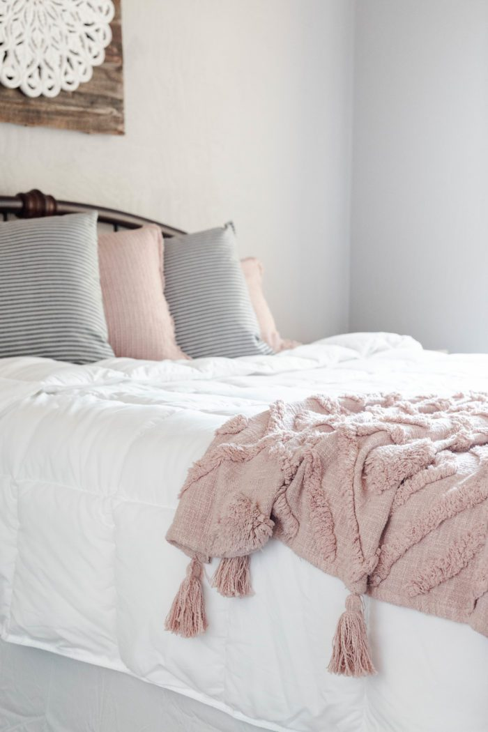 Cozy bedding for creating a welcoming guest room.