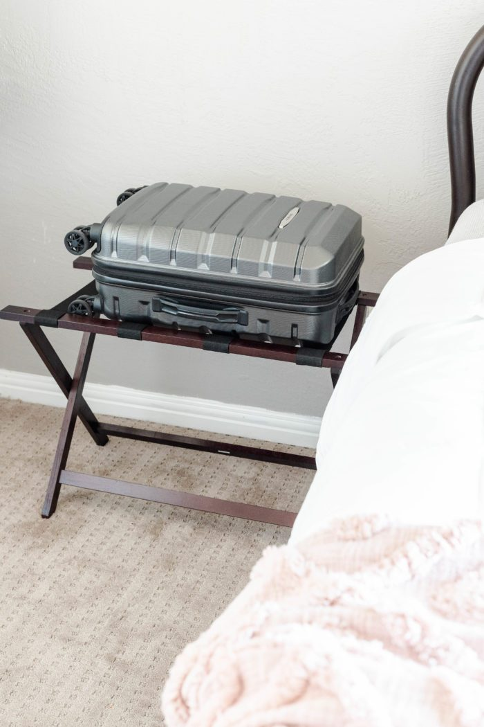 Use a luggage rack to provide a place for overnight guests to easily access their clothing.